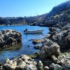 Лагуна залива St Paul голубая в Lindos